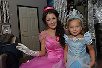 Kira Jade Roebuck, a character princess poses with Charlie Potvin, four, the daughter of Theresa at The Painted Cat princess make-up party. Kira is a professional actress, model and performer.