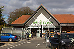 Waitrose supermarket entrance and car park, Saxmundham, Suffolk, England, UK