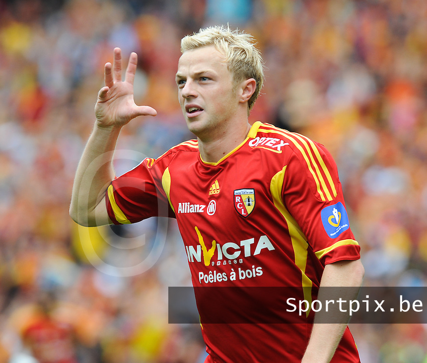 20110813 - LENS , FRANCE : RC Lens'  DAVID POLLET pictured during the soccer match between Racing Club de LENS and TROYES , on the third matchday in the French Ligue 2 at the Stade Bollaert Delelis stadium , Lens . Saturday 13 August 2011 . PHOTO DAVID CATRY