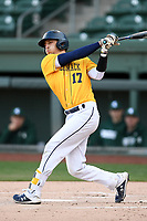 Catcher Wyatt Villella (17) of the Merrimack Warriors bats in a game against the Michigan State Spartans on Saturday, February 22, 2020, at Fluor Field at the West End in Greenville, South Carolina. Merrimack won, 7-5. (Tom Priddy/Four Seam Images)