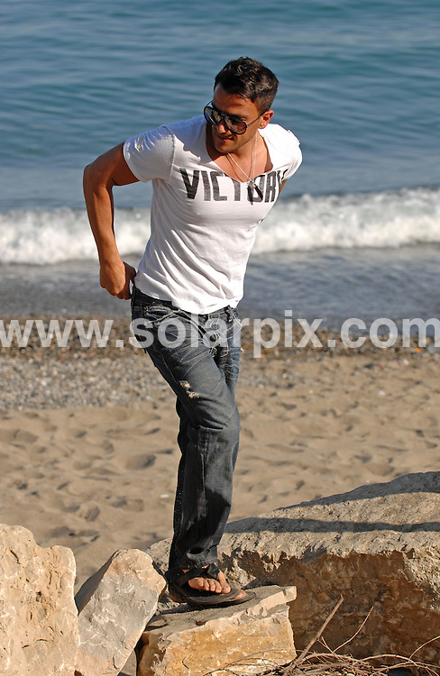 **ALL ROUND EXCLUSIVE PICTURES FROM SOLARPIX.COM**.**WORLDWIDE SYNDICATION RIGHTS**.Peter Andre looked carefree and happy whilst taking a stroll on the beach with his brother michael and his fitness trainer..Meanwhile Ex wife Katie Price prepares for her Marriage on saturday to cage fighter Alex Reid who was also out on his stag party this week..Peter takes a stroll on the beach with his brother michael and his fitness trainer..Peter is on short sunshine break in Spain to do a photo shoot for  his new Calendar which will be out in September...JOB REF: 11591        CS1       DATE:1.07.2010.**MUST CREDIT SOLARPIX.COM OR DOUBLE FEE WILL BE CHARGED**.**MUST AGREE FEE BEFORE ONLINE USAGE**.**CALL US ON: +34 952 811 768 or LOW RATE FROM UK 0844 617 7637**
