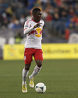 New York Red Bulls midfielder Lloyd Sam (10) brings the ball forward. In a Major League Soccer (MLS) match, the New England Revolution (blue) tied New York Red Bulls (white), 1-1, at Gillette Stadium on May 11, 2013.