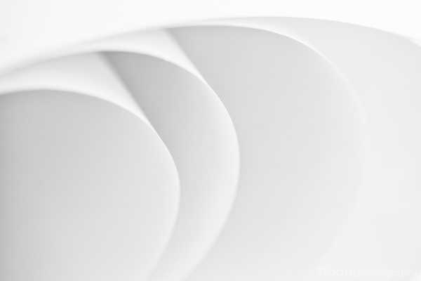 Modern abstract image of curves created by folded paper