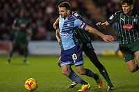 Matthew Bloomfield of Wycombe Wanderers holds off Yann Songo'o of Plymouth Argyle during the Sky Bet League 2 match between Plymouth Argyle and Wycombe Wanderers at Home Park, Plymouth, England on 26 December 2016. Photo by Mark  Hawkins / PRiME Media Images.