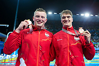 Picture by Alex Whitehead/SWpix.com - 09/04/2018 - Commonwealth Games - Swimming - Optus Aquatics Centre, Gold Coast, Australia - Adam Peaty and James Wilby of England win Silver and Bronze in the Men's 50m Breaststroke final.