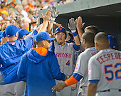 New York Mets shortstop Wilmer Flores (4) is congratulated by his teammates in the dugout after hitting a lead-off home run in the seventh inning against the Baltimore Orioles at Oriole Park at Camden Yards in Baltimore, Maryland on Wednesday, August 19, 2015.  The Orioles won the game 5 - 4.<br /> Credit: Ron Sachs / CNP<br /> (RESTRICTION: NO New York or New Jersey Newspapers or newspapers within a 75 mile radius of New York City)