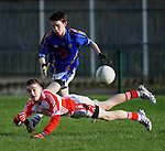 12-02-12:  Cathal O'Bambaire, Pobal Scoil Chorcha Dhuibhne, in action against Tommy Begley, Tralee CBS  in the  Munster Colleges Corn Uí Mhuiri Semi-Final at the  Dr. Crokes grounds, Killarney on Sunday.    Picture: Eamonn Keogh (MacMonagle, Killarney)