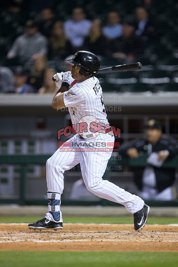 Daniel Fields (5) of the Charlotte Knights follows through on his swing against the Durham Bulls at BB&T BallPark on April 14, 2016 in Charlotte, North Carolina.  The Bulls defeated the Knights 2-0.  (Brian Westerholt/Four Seam Images)