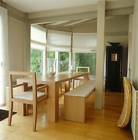 In the dining room two benches have been arranged on either side of the long table creating a simple and monastic feel