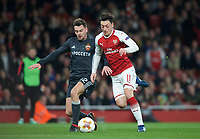 Mesut Ozil of Arsenal & Georgi Schennikov of CSKA Moscow during the UEFA Europa League QF 1st leg match between Arsenal and CSKA Moscow  at the Emirates Stadium, London, England on 5 April 2018. Photo by Andrew Aleksiejczuk / PRiME Media Images.