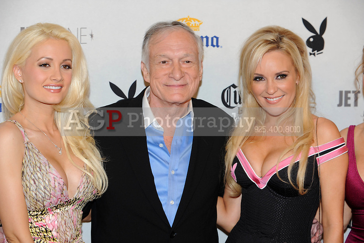 """Playboy Magazine founder Hugh Hefner poses with """"The Girls Next Door"""" stars Holly Madison, left, and Bridget Marquardt at Playboy's ninth annual """"Super Saturday Night""""  party in at Playboy's Desert Oasis and Resort in Chandler, Arizona Saturday February 2, 2008.   (Photo by Alan Greth)"""