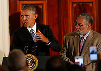 US President Barack Obama delivers remarks, while Lonnie Bunch, the director of the Smithsonian National Museum of African American History and Culture listens,  at the reception in honor of the opening of the museum in the Grand Foyer of the White House September 22, 2016, Washington, DC. <br /> Credit: Aude Guerrucci / Pool via CNP /MediaPunch
