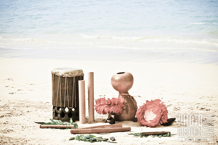 Hula implements including Pahu, (drum), Ipu,(gourd), Puili, (Slit bamboo) uliuli, (feather rattles) Kalaau (sticks), ili ili, (stones) and nose flute