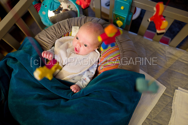 Illustration picture of a newborn baby boy surrounded by toys in his parc (Heverlee, 23/02/2017)