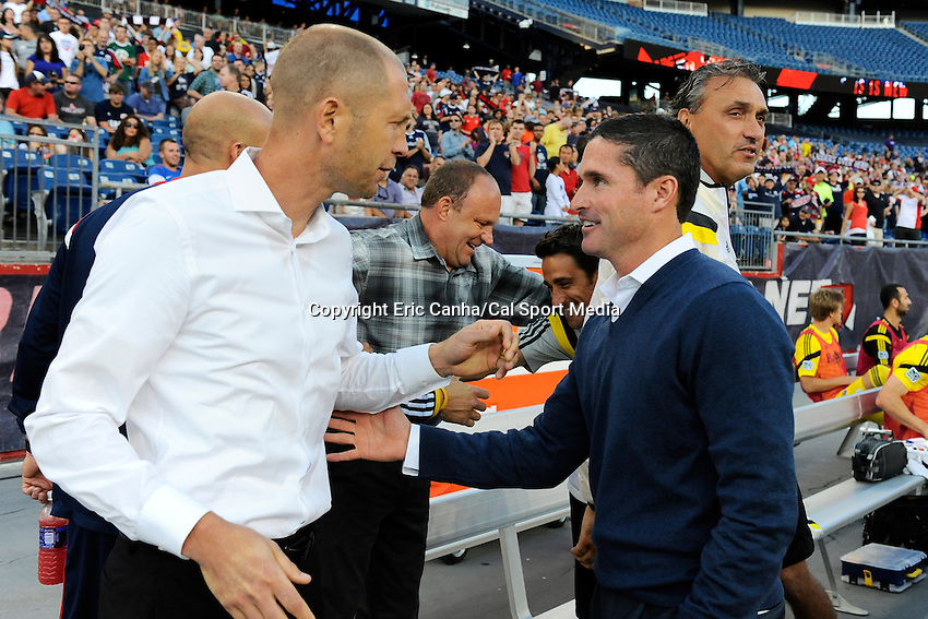 July 26, 2014 - Foxborough, Massachusetts, U.S. - New England Revolution head coach Jay Heaps (right) talks to Columbus head coach Gregg Berhalter (left) before the MLS game between the Columbus Crew and the New England Revolution held at Gillette Stadium in Foxborough Massachusetts.  Eric Canha/CSM