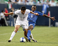Carlos Palacios (14) attempts to slide tackle the ball away from Brian Ching (11).  The US Men's National Team defeated Honduras 2-0 in the semifinals of the Gold Cup at Soldier Field in Chicago, IL on July 23, 2009.