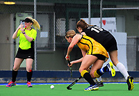 Action from the 2017 Jenny Hair Cup girls hockey match between Taupo Nui A Tia (black and red) and Wellington College (yellow) at Hockey Manawatu Twin Turfs in Palmerston North, New Zealand on Wednesday, 6 September 2017. Photo: Dave Lintott / lintottphoto.co.nz