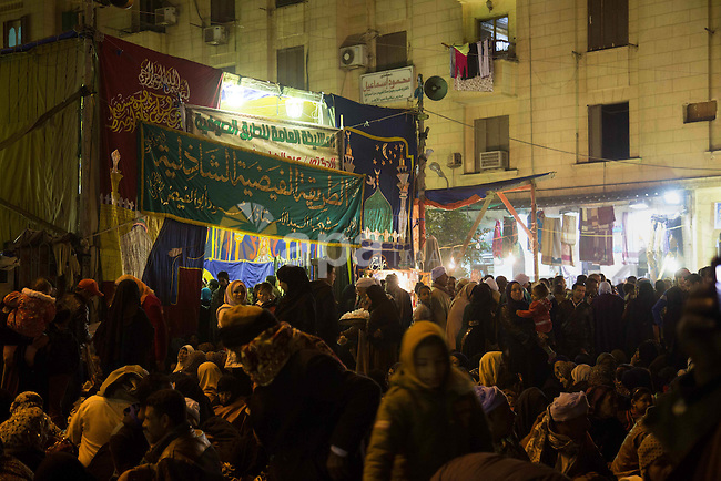 Egyptians celebrate Moulid al-Hussein, a Sufi gathering which commemorates the birth of the Muslim Prophet Muhammad's grandson, in Cairo, Egypt. The event attracts thousands of Muslims from all over the country to the mosque and shrine named for him. Photo by Stringer