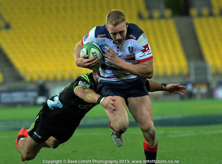 Reece Hodge heads for the tryline during the Super Rugby match between the Hurricanes and Rebels at Westpac Stadium in Wellington, New Zealand on Saturday, 4 May 2019. Photo: Dave Lintott / lintottphoto.co.nz