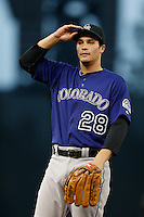 Nolan Arenado #28 of the Colorado Rockies during a game against the Los Angeles Dodgers at Dodger Stadium on April 30, 2013 in Los Angeles, California. (Larry Goren/Four Seam Images)