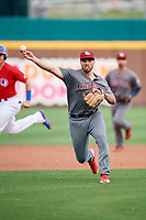 Lehigh Valley IronPigs third baseman Damek Tomscha (47) throws out a runner at home plate during a game against the Buffalo Bisons on June 23, 2018 at Coca-Cola Field in Buffalo, New York.  Lehigh Valley defeated Buffalo 4-1.  (Mike Janes/Four Seam Images)