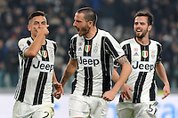 Calcio, semifinale di andata di Tim Cup: Juventus vs Napoli. Torino, Juventus Stadium, 28 febbraio 2017.<br /> Juventus' Paulo Dybala, left, celebrates with teammates Giorgio Chiellini, center, and Miralem Pjanic, after scoring his second goal on a penalty kick during the Italian Cup semifinal first leg football match between Juventus and Napoli at Turin's Juventus stadium, 28 February 2017.<br /> UPDATE IMAGES PRESS/Manuela Viganti
