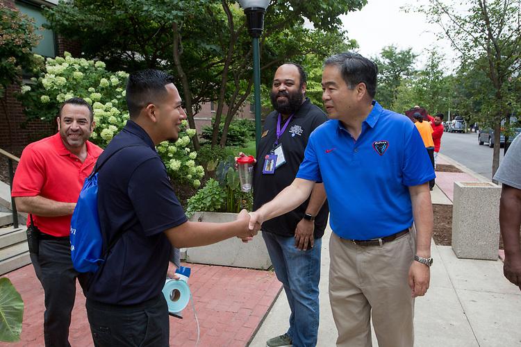 DePaul President A. Gabriel Esteban, Ph.D., greets resident advisor Jaime Gonzalez.  Photo by Diane M. Smutny