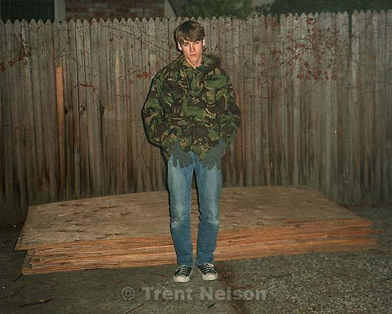 Trent Nelson and stolen wood for skateboard ramp.; San Ramon, CA<br />