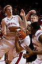 29 February 2012: Toney McCray #0 of the Nebraska Cornhuskers gets the rebound with teammates Brandon Ubel #13 and Caleb Walker #25 by his side blocking out AaronWhite #30 of the Iowa Hawkeyes at the Devaney Sports Center in Lincoln, Nebraska.  Iowa defeated Nebraska 62 to 53.