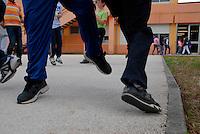Brescia / Italia giugno 2013<br /> Piattaforma di cemento costruita nel giardino della Scuola Elementare Deledda di Brescia per consentire agli alunni di poter giocare all'aperto durante l'intervallo. E' proibito giocare sull'erba a causa della contaminazione.<br /> Foto Livio Senigalliesi