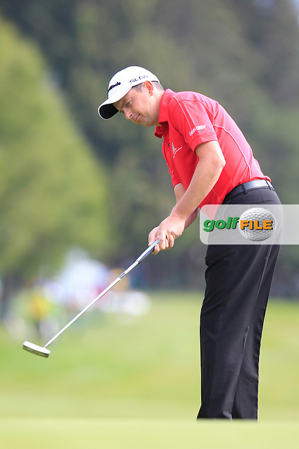 Peter LAWRIE (IRL) putts on the 10th green during Thursday's Round 1 of the 2014 Omega European Masters held at the Crans Montana Golf Club, Crans-sur-Sierre, Switzerland.: Picture Eoin Clarke, www.golffile.ie: 4th September 2014