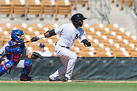 Glendale Desert Dogs left fielder Estevan Florial (13), of the New York Yankees organization, follows through on his swing in front of catcher P.J. Higgins (12) during an Arizona Fall League game against the Mesa Solar Sox at Camelback Ranch on October 15, 2018 in Glendale, Arizona. Mesa defeated Glendale 8-0. (Zachary Lucy/Four Seam Images)