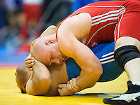 11 MAY 2014 - SHEFFIELD, GBR - Mark Cocker attempts to pin an opponent during one of his 97kg category freestyle matches at the British 2014 Senior Wrestling Championships at EIS in Sheffield, Great Britain (PHOTO COPYRIGHT © 2014 NIGEL FARROW, ALL RIGHTS RESERVED)