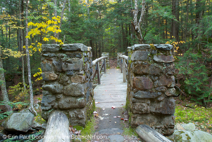 """Built 1923-1924, Memorial Bridge crosses Cold Brook along """"The Link"""" trail in Randolph, New Hampshire. This bridge is a memorial to Randolph's early pathmakers (19th-century trail builders). These legendary pathmakers are responsible for cutting many of the trails in the Northern Presidential Range, and they include Eugene B. Cook, J. Rayner Edmands, James Gordon, Hubbard Hunt, Charles E. Lowe, William G. Nowell, William H. Peek, George Sargent, and Laban Watson."""