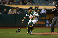 OAKLAND, CA - AUGUST 14:  Bruce Maxwell #13 of the Oakland Athletics chases a wild pitch against the Kansas City Royals during the game at the Oakland Coliseum on Monday, August 14, 2017 in Oakland, California. (Photo by Brad Mangin)