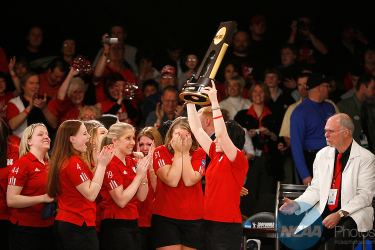 11 APR 2009:  Members of the University of Nebraska women's bowling team hoist the trophy after their victory over the University of Central Missouri during the Division I Women's Bowling Championship held at the Super Bowl Lanes of Canton in Canton, MI.  The University of Nebraska defeated the University of Central Missouri 4-1 to win the national title.  Jeffrey Sauger/NCAA Photos.
