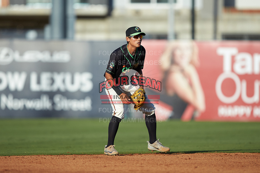 Ocelotes de Greensboro second baseman Ji-Hwan Bae (51) on defense against the Hickory Crawdads at First National Bank Field on June 11, 2019 in Greensboro, North Carolina. The Crawdads defeated the Ocelotes 2-1. (Brian Westerholt/Four Seam Images)