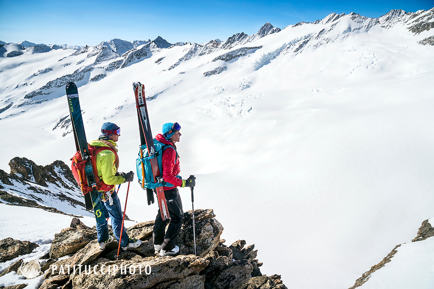 Ski tourers on the summit of the  Ränfenhorn before making the huge descent of the Rosenlaui Glacier on the last day of the Berner Haute Route, Switzerland