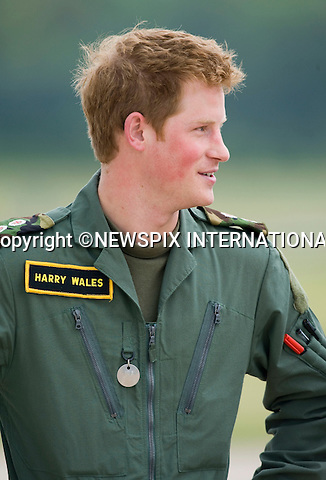 """PRINCE WILLIAM and PRINCE HARRY.Attend a photocall in front of a Squirrel Helicopter and a Griffin Helicopter, to mark their pilot training with the RAF. RAF Shawbury_18/06/2009.Mandatory Photo Credit: ©Dias/Newspix International..**ALL FEES PAYABLE TO: """"NEWSPIX INTERNATIONAL""""**..PHOTO CREDIT MANDATORY!!: NEWSPIX INTERNATIONAL(Failure to credit will incur a surcharge of 100% of reproduction fees)..IMMEDIATE CONFIRMATION OF USAGE REQUIRED:.Newspix International, 31 Chinnery Hill, Bishop's Stortford, ENGLAND CM23 3PS.Tel:+441279 324672  ; Fax: +441279656877.Mobile:  0777568 1153.e-mail: info@newspixinternational.co.uk"""
