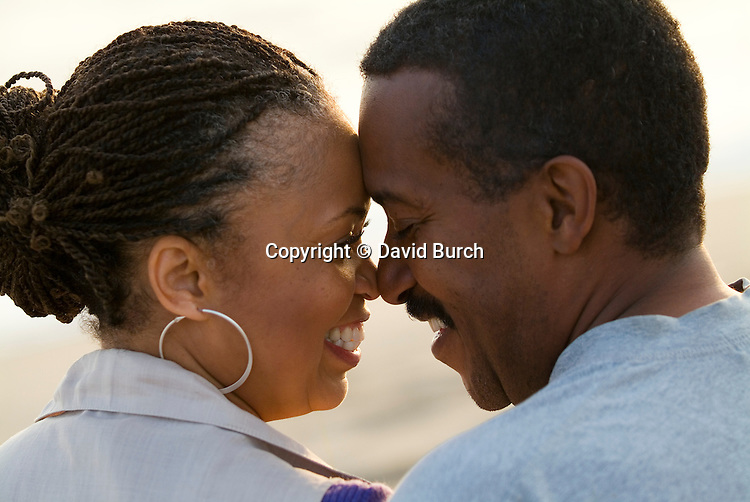 Mature couple face to face, smiling, close-up