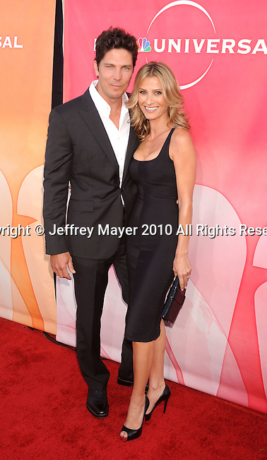 BEVERLY HILLS, CA. - July 30: Michael Trucco and wife Sandra Trucco arrive at NBC Universal's Press Tour All Star Party at The Beverly Hilton Hotel on July 30, 2010 in Beverly Hills, California.