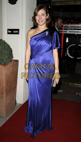CAMILLA RUTHERFORD.The Red Room Launch Party at Les Ambassadeurs Club, Mayfair, London, England..November 2nd 2009.full length one shoulder purple blue black dress long maxi silk satin clutch bag silver.CAP/CAN.©Can Nguyen/Capital Pictures.
