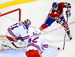 23 January 2010: New York Rangers' goaltender Matt Zaba makes a third period save on Maxim Lapierre of the Montreal Canadiens at the Bell Centre in Montreal, Quebec, Canada. The Canadiens shut out the Rangers 6-0. Mandatory Credit: Ed Wolfstein Photo