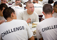 mr-cadets0530   159009- Project Challenge cadet  Michael Jensen looks up while eating breakfast in the chow hall at Arizona Project Challenge in Queen Creek. The program provides a live-in military based education for high school drop outs.  Michael Jensen, of Gilbert, will be the first Arizona Project Challenge cadet to graduate with a high school diploma from Sequoia Choice Arizona Distance Learning in Mesa. (Pat Shannahan/ The Arizona Republic)