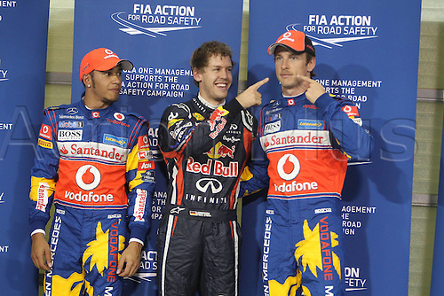 12.11.2011 Abu Dhabi, United Arab Emirates. Yas Marina Circuit Sebastian Vettel Red Bull Racing before Lewis Hamilton and Jenson Button McLaren Mercedes  during the qualification round of the Abu Dhabi FIA F1 Grand Prix