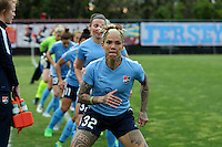 Piscataway, NJ, May 7, 2016.  Tasha Kai (32) and the other starters of Sky Blue take a last minute warmup  prior to the game between Sky Blue FC and the Western New York Flash.  The Western New York Flash defeated Sky Blue FC, 2-1, in a National Women's Soccer League (NWSL) match at Yurcak Field.