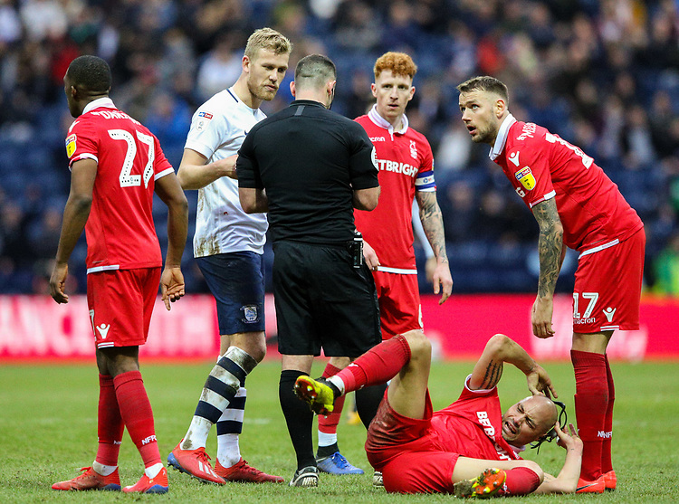 Referee Tim Robinson talks to Preston North End's Jayden Stockley after a challenge on Nottingham Forest's Yohan Benalouane<br /> <br /> Photographer Alex Dodd/CameraSport<br /> <br /> The EFL Sky Bet Championship - Preston North End v Nottingham Forest - Saturday 16th February 2019 - Deepdale Stadium - Preston<br /> <br /> World Copyright © 2019 CameraSport. All rights reserved. 43 Linden Ave. Countesthorpe. Leicester. England. LE8 5PG - Tel: +44 (0) 116 277 4147 - admin@camerasport.com - www.camerasport.com