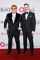 NEW YORK, NY - November 5: Elton John and David Furnish attend Elton John AIDS Foundation's 17th Annual An Enduring Vision Benefit at Cipriani 42nd Street in New York City on November 05, 2018. <br /> CAP/MPI/RW<br /> &copy;RW/MPI/Capital Pictures