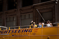 A tour guide gesture as he talks to tourist on a sightseeing bus in Toronto April 20, 2010.
