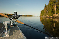 Fishing rod trolling for musky off the motor boat